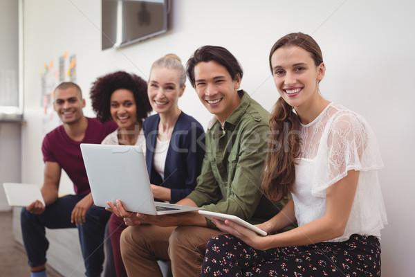 Portré boldog fiatal üzlet kollégák együtt dolgozni Stock fotó © wavebreak_media