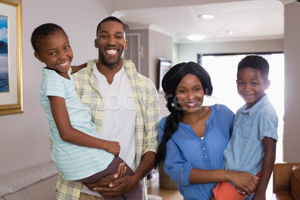 Smiling family in living room at home Stock photo © wavebreak_media