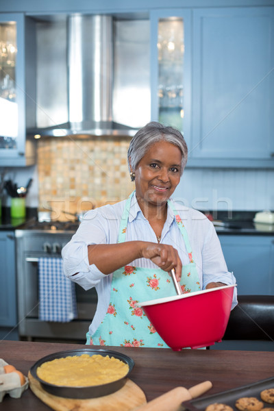 Portrait of senior woman preparing food Stock photo © wavebreak_media