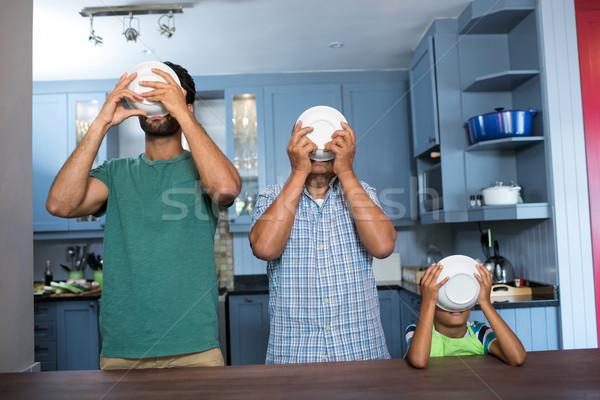 Familie ontbijt permanente tabel keuken liefde Stockfoto © wavebreak_media