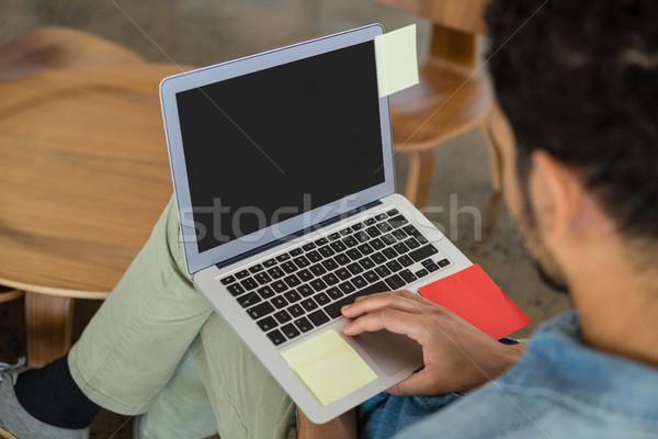 男 ラップトップを使用して オフィス ビジネスマン 作業 壁 ストックフォト © wavebreak_media