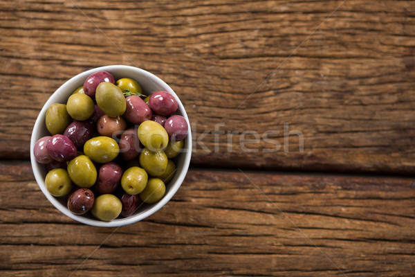Stock photo: Marinated olives in white bowl