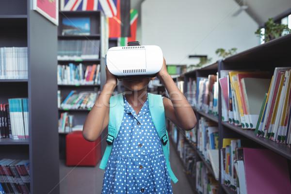 Girl wearing virtual reality simulator in library Stock photo © wavebreak_media