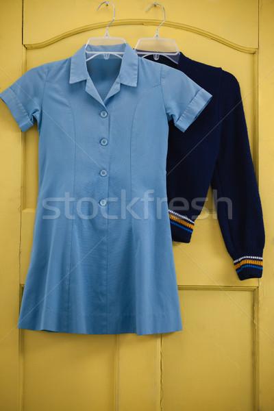 Iskolai egyenruha táska akasztás ajtó citromsárga ablak Stock fotó © wavebreak_media