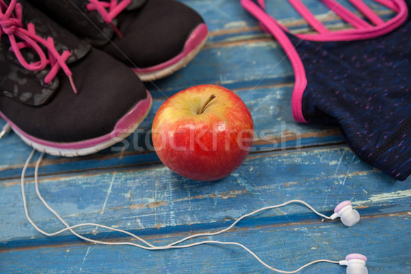 High angle view of womenswear with apple and headphones Stock photo © wavebreak_media
