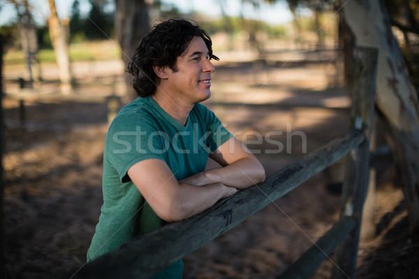 Adam ahşap çit çiftlik gülen Stok fotoğraf © wavebreak_media