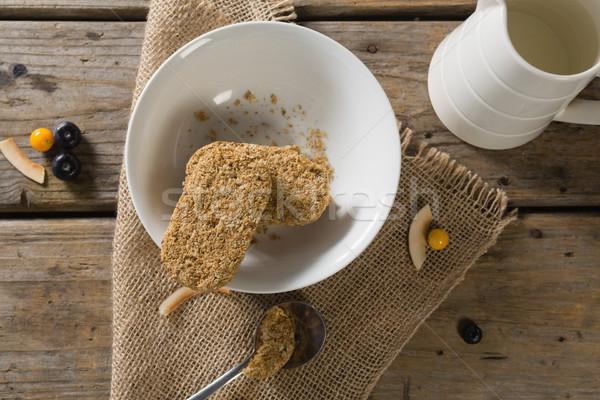 Granola bar leite mesa de madeira livro fitness Foto stock © wavebreak_media