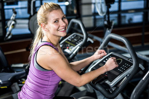 笑顔の女性 自転車 行使 ジム 女性 スポーツ ストックフォト © wavebreak_media