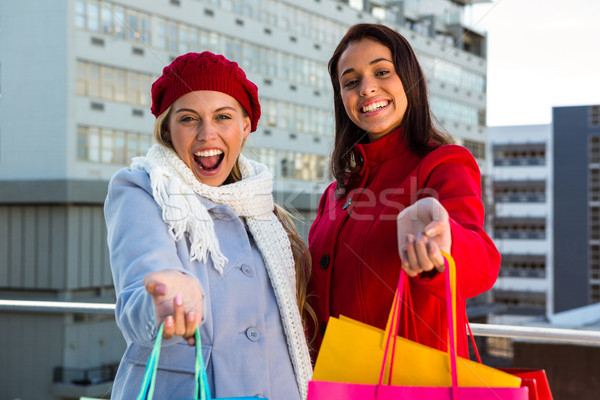 Two girls showing their shopping bags Stock photo © wavebreak_media