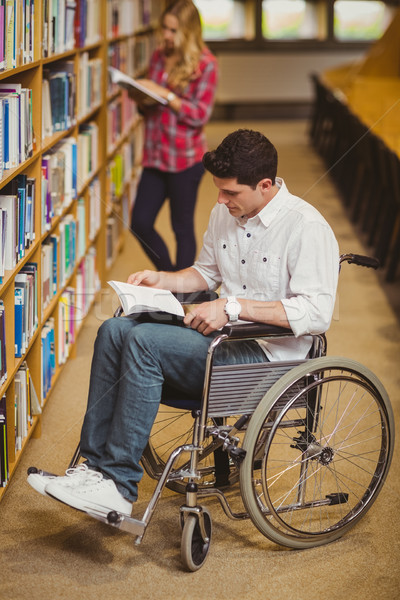Student in wheelchair talking with classmate Stock photo © wavebreak_media