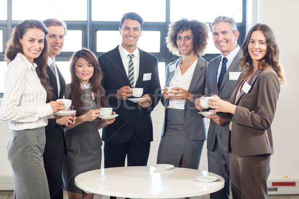 Gens d'affaires permanent ensemble bureau portrait souriant Photo stock © wavebreak_media