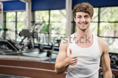 Muscular man posing with thumbs up Stock photo © wavebreak_media