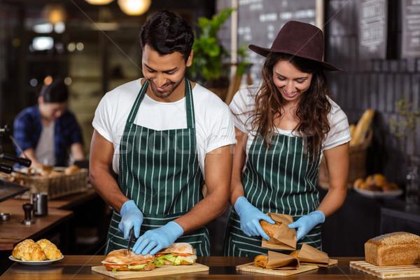Smiling baristas preparing sandwiches Stock photo © wavebreak_media