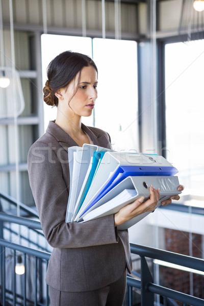 Tired overworked busy businesswoman  Stock photo © wavebreak_media