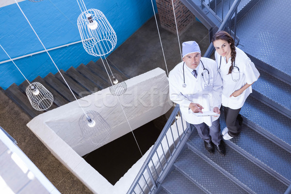 Portrait of doctors standing on staircase Stock photo © wavebreak_media