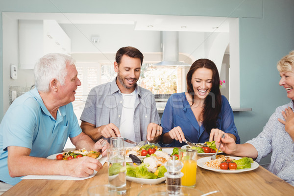 Family laughing while sitting at dining table Stock photo © wavebreak_media