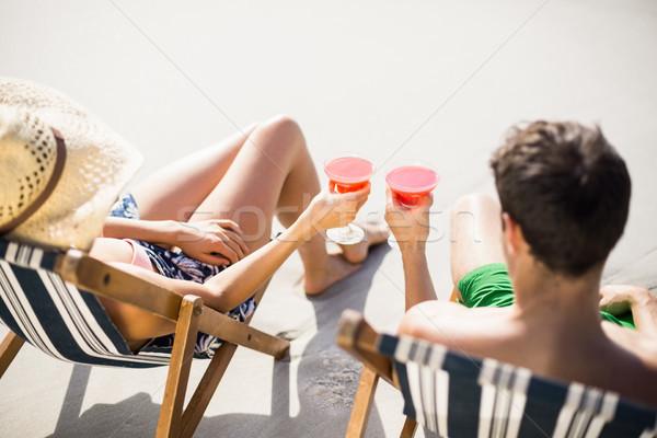 Couple séance fauteuil cocktail boire plage Photo stock © wavebreak_media
