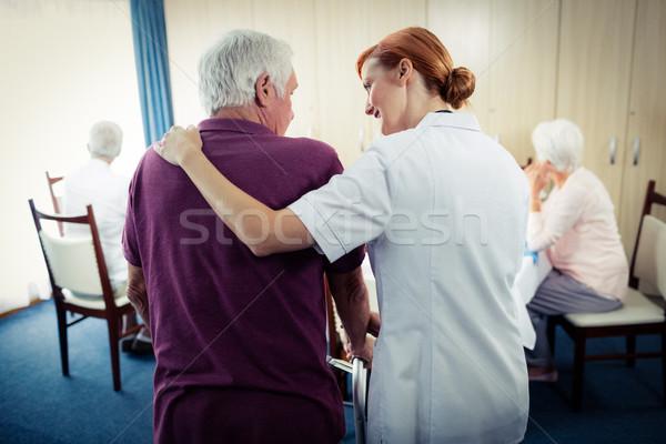 Nurse assisting a senior using a walker  Stock photo © wavebreak_media