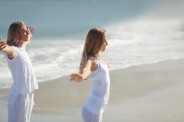 Man and woman performing yoga Stock photo © wavebreak_media