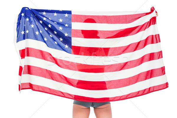 Atleta posa bandiera americana vittoria bianco donna Foto d'archivio © wavebreak_media