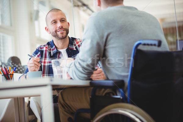 Biznesmen handicap kolega biuro młodych Zdjęcia stock © wavebreak_media
