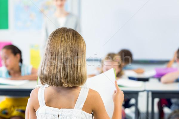 вид сзади девушки чтение книга классе ребенка Сток-фото © wavebreak_media