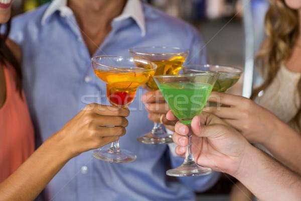 Friends toasting martini and cocktail glass Stock photo © wavebreak_media