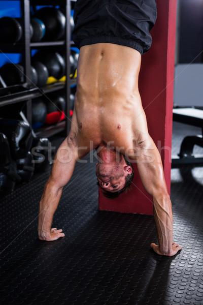 Shirtless athlete doing handstand  Stock photo © wavebreak_media