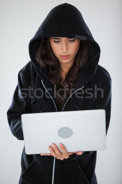 Hacker za pomocą laptopa biały komputera notebooka piłka Zdjęcia stock © wavebreak_media