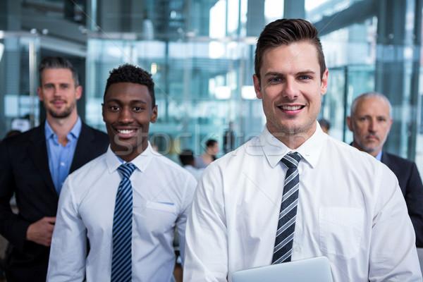 Retrato empresarios oficina feliz pie negocios Foto stock © wavebreak_media