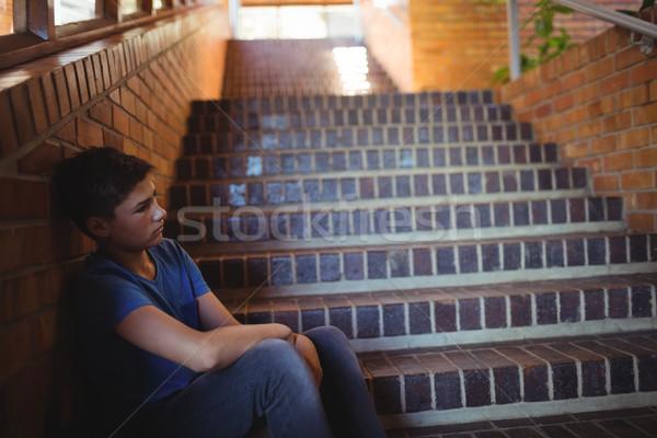 Triste scolaro seduta sola scala scuola Foto d'archivio © wavebreak_media