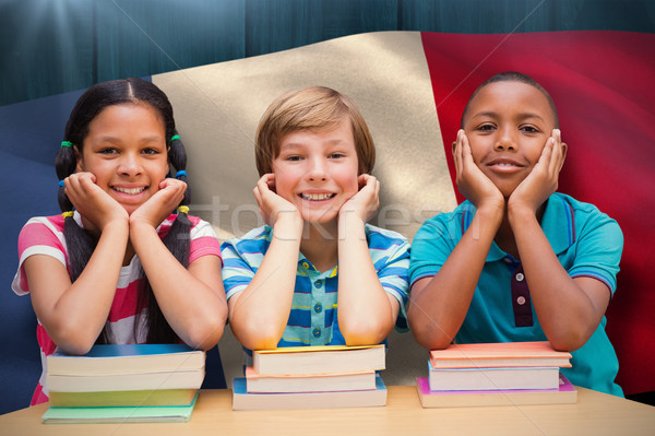 Composite image of cute pupils looking at camera in library  Stock photo © wavebreak_media