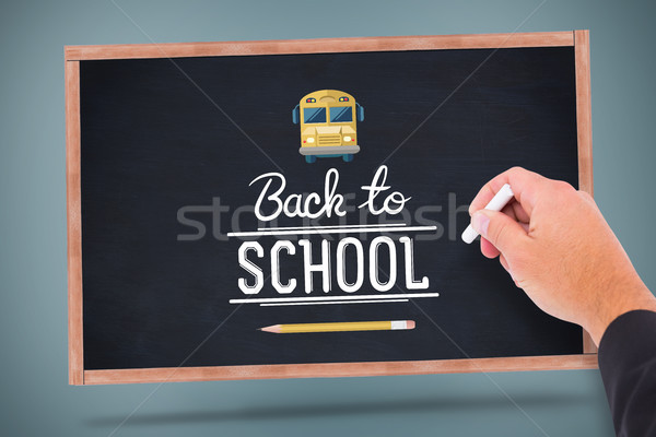 összetett kép kéz ír kréta vissza az iskolába Stock fotó © wavebreak_media