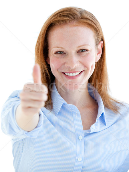 Self-assured business woman doing a thumb-up  Stock photo © wavebreak_media