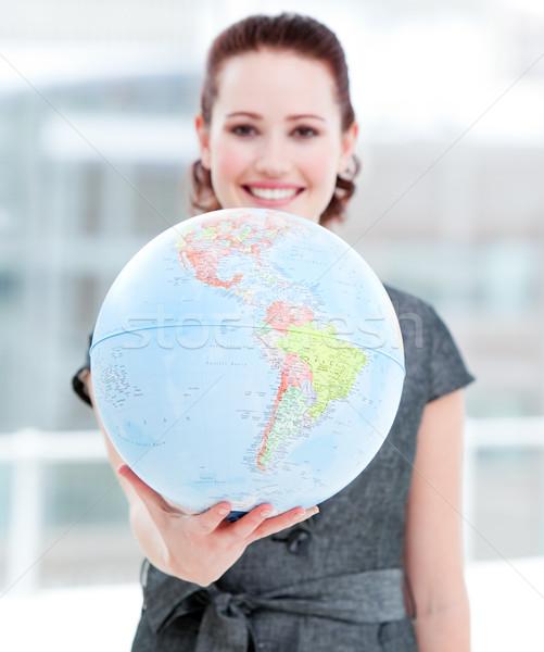 Assertive businesswoman holding a terrestrial globe Stock photo © wavebreak_media
