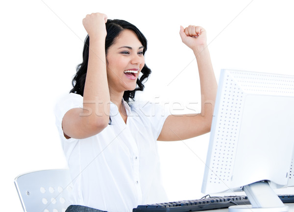 Positive  businesswoman punching the air in front of her compute Stock photo © wavebreak_media