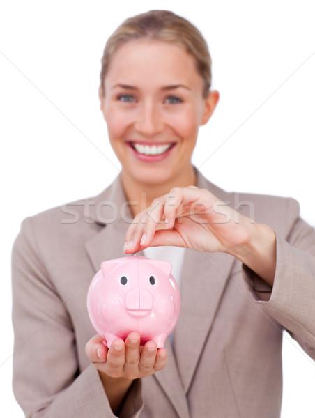 Tolakodó üzletasszony takarékosság pénz persely izolált Stock fotó © wavebreak_media