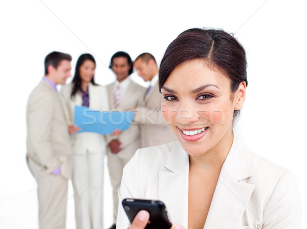 Portré csinos üzletasszony néz mobiltelefon csapat Stock fotó © wavebreak_media