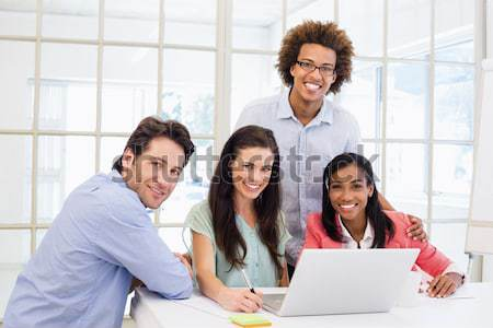 A business group showing diversity using a laptop  Stock photo © wavebreak_media