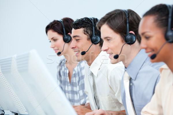 Internationale klantenservice hoofdtelefoon call center computer gelukkig Stockfoto © wavebreak_media