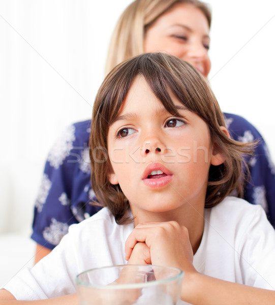 Captivated child watching television with his mother Stock photo © wavebreak_media