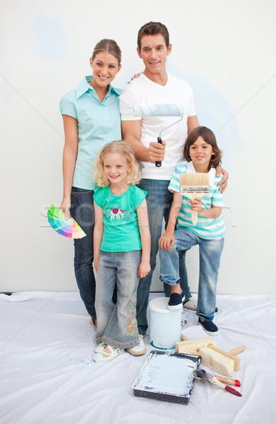 Smiling family decorating their house  Stock photo © wavebreak_media
