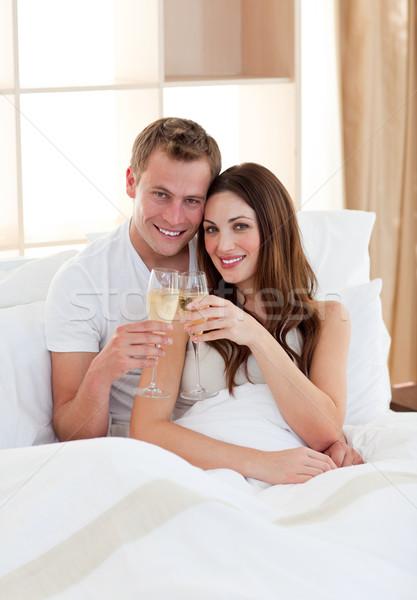 Szeretetteljes pár iszik pezsgő ágy otthon Stock fotó © wavebreak_media
