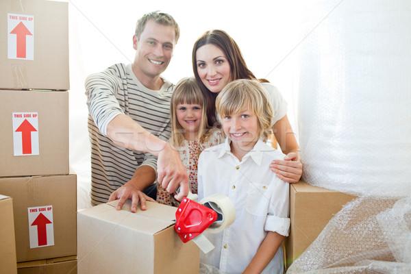 Lively family packing boxes Stock photo © wavebreak_media