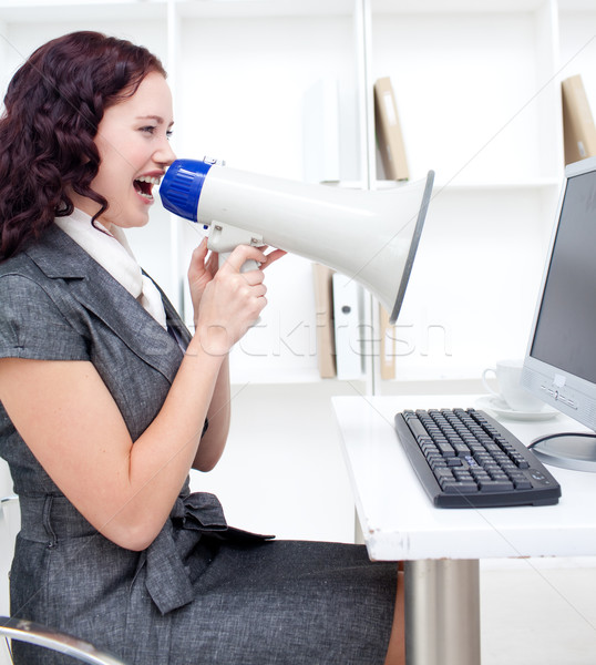Businesswoman yelling through a megaphone Stock photo © wavebreak_media