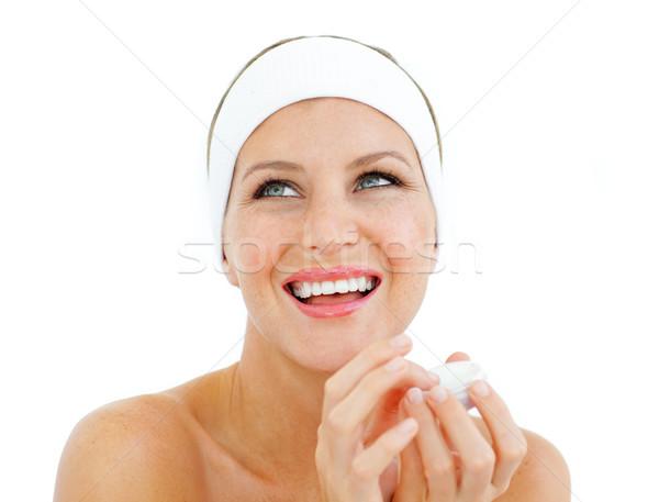 Risonho mulher lábio bálsamo isolado Foto stock © wavebreak_media