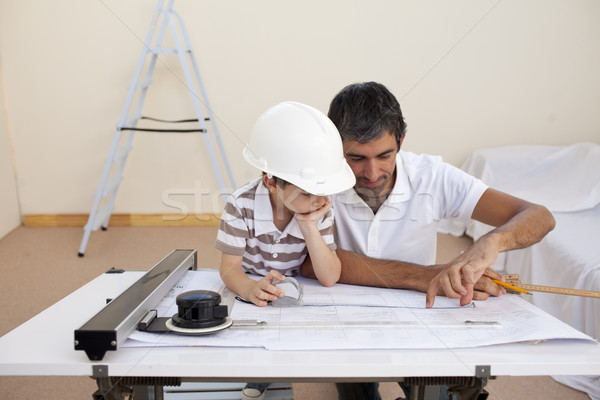 Father and son studying working with plans Stock photo © wavebreak_media