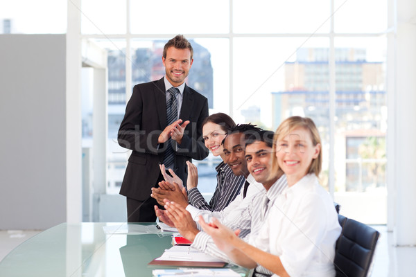 Stock photo: Happy business people after a presentation
