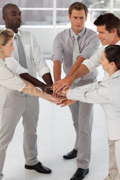 Close-up of smiling business team with hands together Stock photo © wavebreak_media