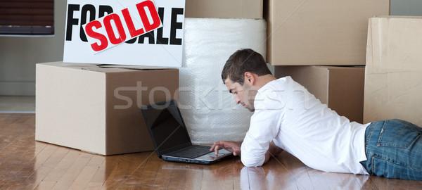 Relaxed man lying on the floor using a laptop Stock photo © wavebreak_media